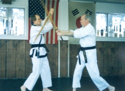 Cliff Martin giving instruction on defense with a sword